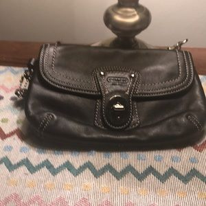 Black leather Coach wristlets